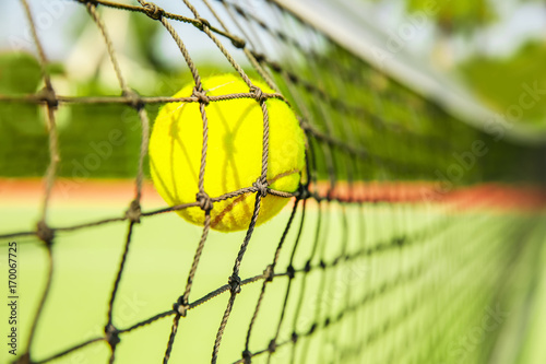 Fotografija  Tennis ball in net, closeup