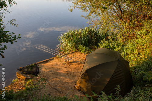 Carp Angler scenic landscape overlooking lake at Dawn