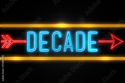 Fotografie, Tablou Decade  - fluorescent Neon Sign on brickwall Front view