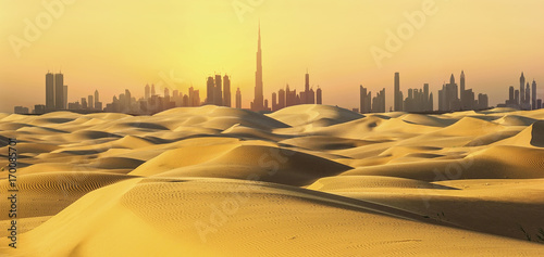 Dubai skyline in desert at sunset.