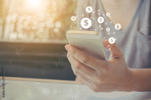 Fotografia  Asian woman hand using mobile phone with online transaction application, Concept