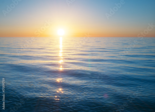 Photo sur Toile Mer coucher du soleil Sundown on the sea. Nature relax composition.