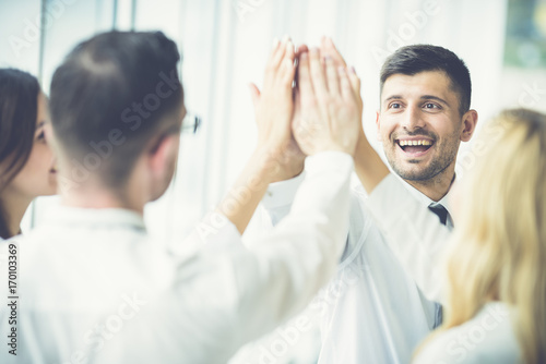The happy people greeting with a high five buy this stock photo the happy people greeting with a high five m4hsunfo