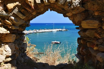 Traditional beautiful Greek village of Panormos on the island of Crete. Summer background for travel and holidays.