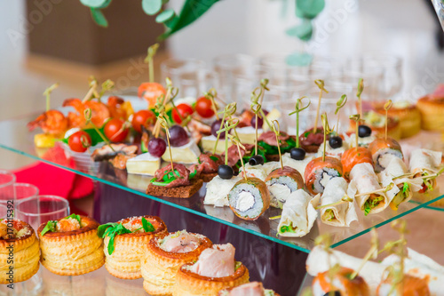 Snacks, fish and meat specialities on the buffet. A gala reception. Served tables. Catering.