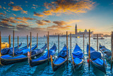 Fototapeta  - Blue gondolas in Venice at sunset