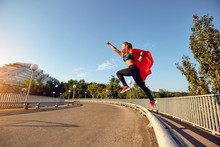 A Girl Runner In A Superhero C...