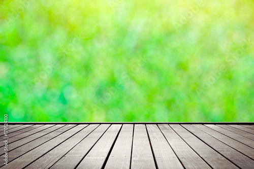 In de dag Lime groen Wooden floor perspective and green forest with ray of light, blured with bokeh
