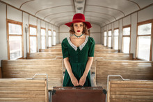 Woman With Suitcase In Retro T...