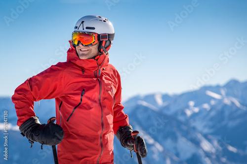 Wall Murals Winter sports Portrait of a happy male skier in the alps