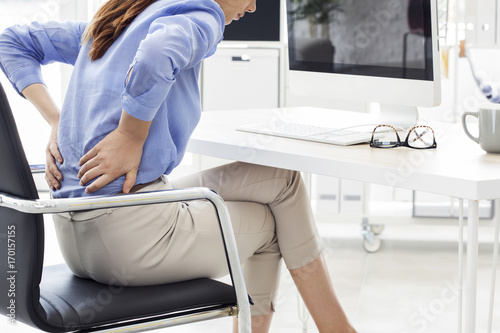 Fotografie, Obraz  Businesswoman with pain in back