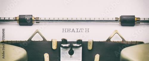 Cuadros en Lienzo  Health word in capital letters on white sheet