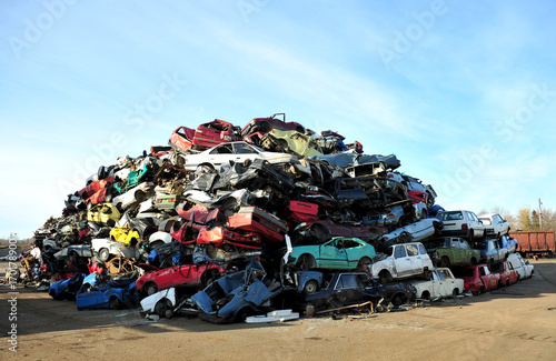 Old damaged cars on the junkyard waiting for recycling Canvas Print