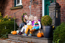 Kids At House Porch On Autumn ...