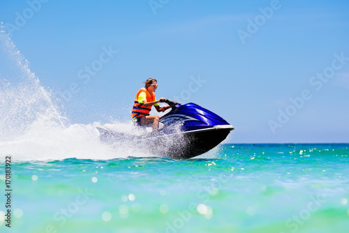 Canvas Prints Water Motor sports Teenager on water scooter. Teen age boy water skiing.