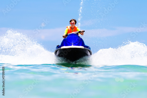 Garden Poster Water Motor sports Teenager on water scooter. Teen age boy water skiing.