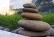 Harmony and balance, simple pebble tower in the grass, simplicity, five stones