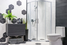 Modern Spacious Bathroom With Bright Tiles With Glass Shower, Toilet And Sink. Side View