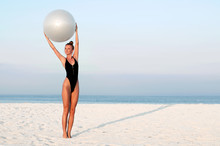 Fitness Woman With Fit Ball On...