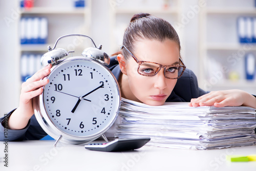 Businesswoman in time management concept Poster