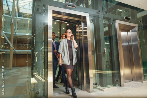Business team group exit on elevator Canvas Print