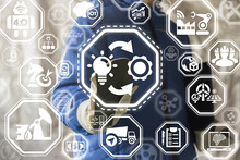 Implementation Smart Industry 4.0 Process Execution Engineering Concept. Worker Man Presses Light Bulb Gear Circular Arrows Button On A Virtual Industrial IT Interface.