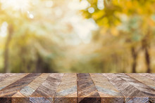 Empty Old Rustic Wood Plank Table Top With Blur Forest Tree With Sunlight,Autumn Fall Backgorund,Mock Up For Display Or Montage Of Product,banner For Advertise On Online.