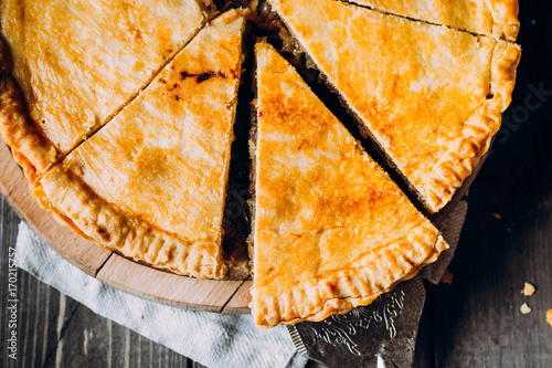Photographie Fresh Meat pie on the wooden board on table background