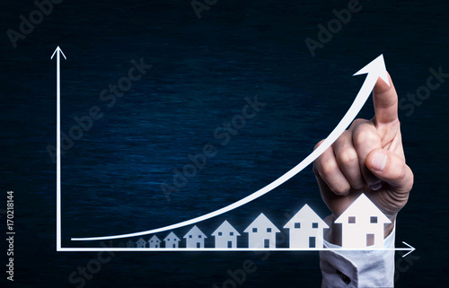 Fotografía Business hand touching on a real estate graph.