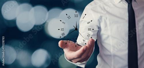 Cuadros en Lienzo Businessman holding clock. Business time management .