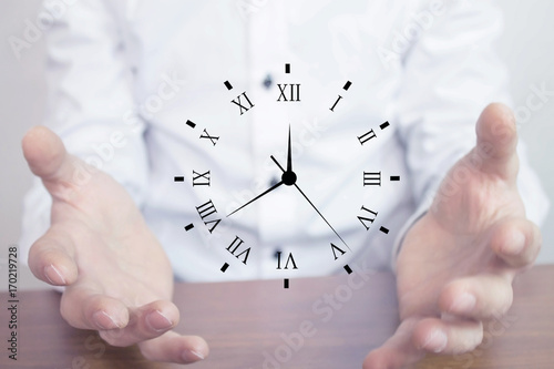 Businessman holding clock. Business time management .