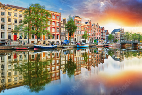 Photo Stands Amsterdam Amsterdam Canal houses at sunset reflections, Netherlands, panorama