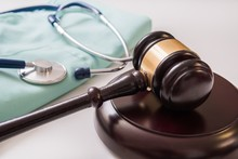 Gavel And Stethoscope In Backg...