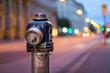 canvas print picture - Hydrant am Abend, Lichter der Großstadt, Breitbild