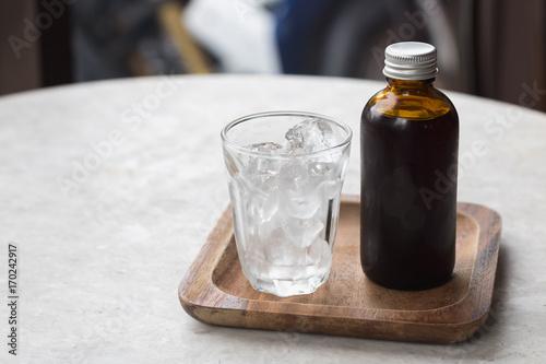 Obraz na płótnie Coffee cold brew in brown bottle