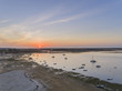 Sunrise aerial seascape, in Ria Formosa wetlands natural park, shot at 60m altitude over Cavacos beach. Algarve.