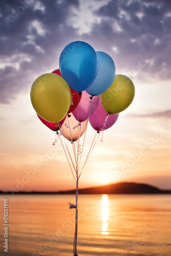Foto op Canvas Ballon Colorful Balloons On The Bridge At The Sea And A Beautiful Sunset. Birthday Party Balloons