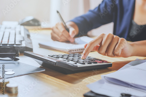 businessman using calculator on desk office business financial accounting concep Canvas Print