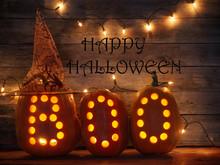 Halloween Pumpkins On Wooden B...