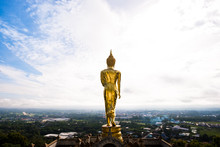 Golden Buddha Statue Standing On A Mountain At Wat Phra That Khao Noi, Nan Province, Thailand With  Wonderful Sky