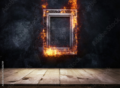 Cuadros en Lienzo Fire Burning silver Antique picture Frame on dark grunge wall with Wooden table top, Empty ready for product display or montage