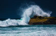 Powerful Ocean Wave Breaking On The Rock
