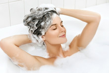Woman Is Washing Her Hair With...