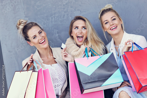 Fototapeta Happy group of friends shopping in autumn season obraz