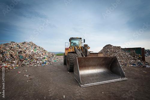 Fotografija  Bulldozer in front of pile of waste at city landfill.