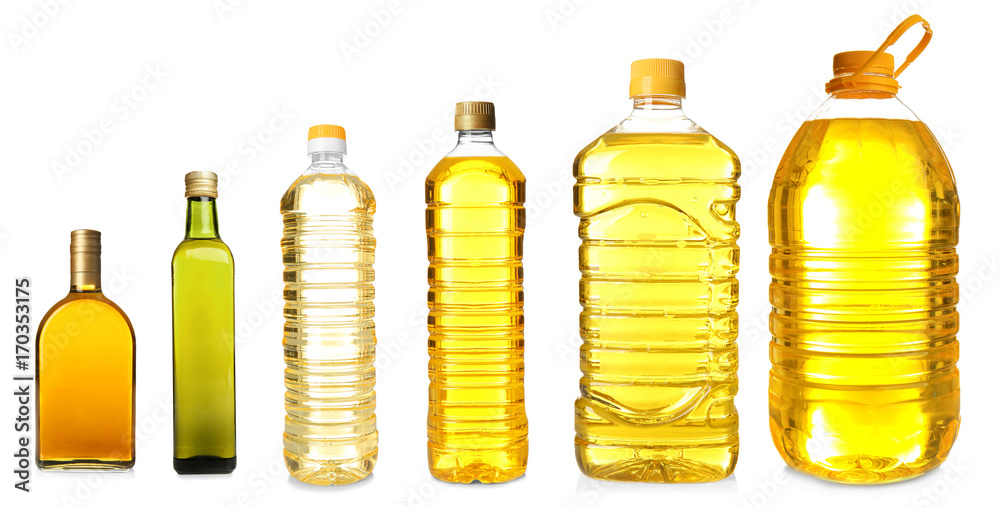 Fototapeta Different bottles with cooking oil on white background