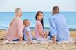 Cute children with grandparents on sea beach