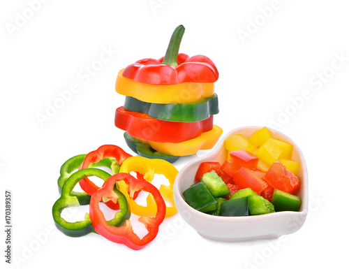 Canvas Print colorful slice of sweet bell pepper or capsicum isolated on white background