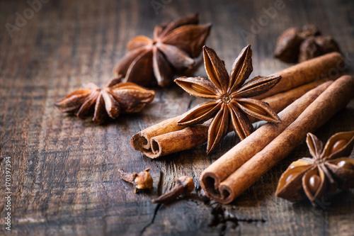 Fototapeta Traditional Christmas spices - star anise, cinnamon sticks and cloves for festive baking obraz