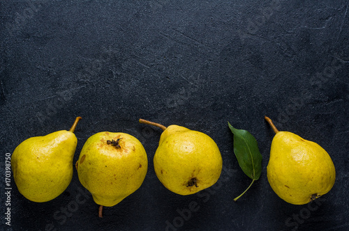 Ripe yellow pear on a dark background